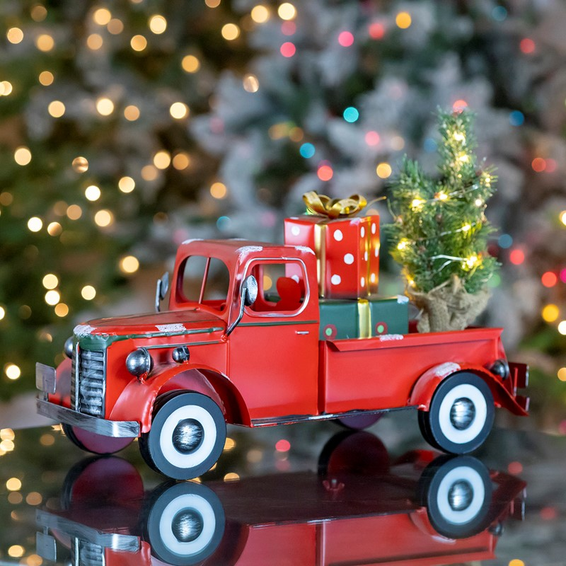 Snow Covered Pickup Truck with Lighted Christmas Tree and Gifts