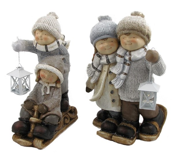 SET OF 2 TUSHKAS ON SLEIGH AND WITH SNOW SHOES