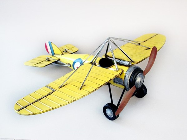WWII Inspired Metal Model Airplane in Pale Yellow